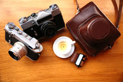 Vintage camera on wooden table Stock Photos