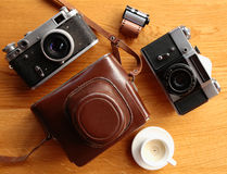 Vintage camera on wooden table Royalty Free Stock Photos