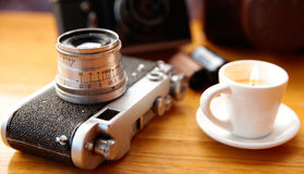 Vintage camera on wooden table Stock Image