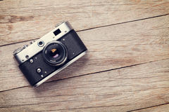 Vintage camera on wooden table Stock Images