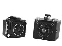 Vintage Cameras. Two examples of vintage cameras from the dark ages of modern photography Stock Photography