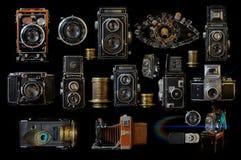 Vintage cameras.A collage of vintage cameras on a black background. Stock Image