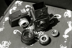 Vintage cameras and lens Royalty Free Stock Photos