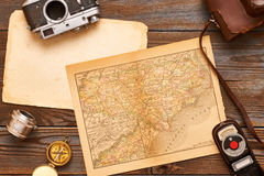 Vintage cameras and lenses on antique XIX century map Stock Image