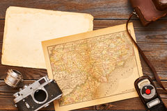 Vintage cameras and lenses on antique XIX century map Stock Photos