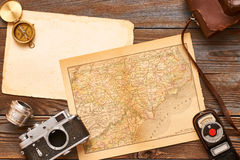 Vintage cameras and lenses on antique XIX century map Stock Photography