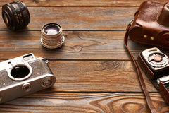 Vintage cameras and lenses on wooden background Royalty Free Stock Image