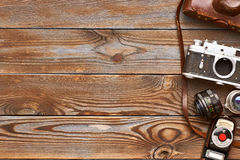 Vintage cameras and lenses on wooden background Stock Photography
