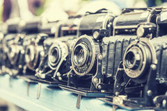 Vintage cameras. Many old cameras with photographic vintage effect Stock Images