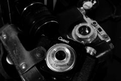 Vintage cameras on a mirrored table stock images