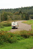 Vintage Camper On Road in Autumn stock photography