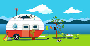 Vintage camper at seaside. Cartoon travelling scene with a vintage camper, a fire pit, camping table and laundry line, EPS 8 vector illustration, no royalty free illustration