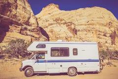 Vintage Camper in Utah. Sandstone Canyon. Class C Recreation Vehicle. Vintage Color Grading stock photos