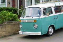 Vintage Camper Van. Camper Van parked outside a house Royalty Free Stock Images