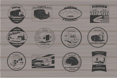 Vintage camping and outdoor adventure emblems, logos and badges. Camping equipment. Camp trailer in the forest on wood Stock Images