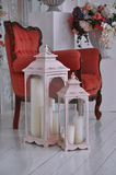 Vintage candle on the background of chairs. Vintage candle on red chair stock photo