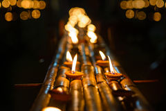 Vintage candle cup in thai temple at night Royalty Free Stock Photos