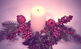 Vintage candle with fir and pomegranate. Christmas postcard stock photography
