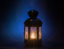 Vintage candle holder. Burning candle close up. Royalty Free Stock Photos