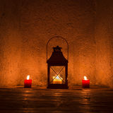 Vintage candlelit in metal lantern Stock Images