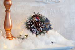 Vintage candles on the mantelpiece. Antique bronze candle on the mantel, decorated for Christmas Stock Photo