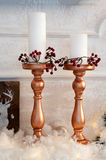 Vintage candles on the mantelpiece. Antique bronze candle on the mantel, decorated for Christmas Royalty Free Stock Images