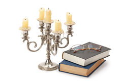 Vintage candlestick books and glasses Stock Image
