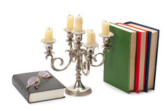 Vintage candlestick books and glasses Stock Photo