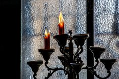 Vintage candlestick with candles. Dark background royalty free stock photos