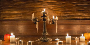 Vintage candlestick with candles, two apples and a few candles o Royalty Free Stock Image