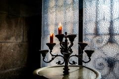 Vintage candlestick with candles. Dark background stock images
