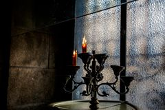 Vintage candlestick with candles. Dark background stock photo