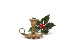 Vintage candlestick with holly berry Royalty Free Stock Photo