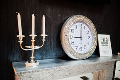 Vintage candlestick with silver clock Stock Photography