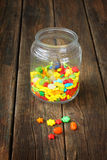 Vintage candy jar on wooden table Stock Photography