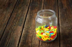 Vintage candy jar on wooden table Stock Image