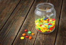 Vintage candy jar on wooden table Stock Images