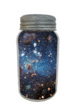 Vintage canning jar containing universe isolated. Vintage canning jar with gray metal lid, containing elements of space and the universe. Isolated on white royalty free stock photo