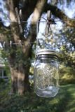 Vintage Canning Jar Outdoors on Clothesline Royalty Free Stock Image
