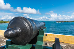Vintage cannon facing the Caribbean ocean defending the bay.  Vi. Ew from back of cannon to tip Royalty Free Stock Image