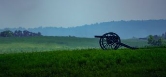 Vintage Cannon overlooking old battlefield royalty free stock image