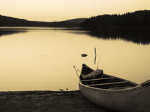 Vintage Canoe on Lake. Enjoying the evening sunset from tent on Rankin Lake, Northern Ontario Stock Images