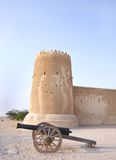 A vintage canon & the southern tower of Zubarah fort, Qatar Stock Photos