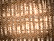 Vintage canvas background textured. Vintage brown canvas background textured royalty free stock photography