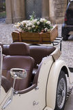 Vintage car. White vintage car with laggage and flower bouquet Royalty Free Stock Photography
