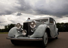 Vintage car. Low angle view of light blue vintage car parked outdoors Royalty Free Stock Photography