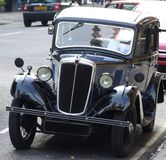 Vintage Car. A vintage car parked on the road Royalty Free Stock Photography