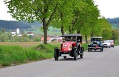 Vintage car. KRIVONOSKA - MAY 8: 1922 RENAULT KJ1 and 1930 FORD A on Car Competition during 40th Czech Veteran Rallye. May 8, 2010 in Krivonoska, Czech Republic royalty free stock image