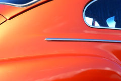 Vintage car. Orange colored vintage car, close-up stock images