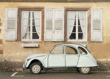 Vintage Car. An old European car next to a medieval house in the Alsace region of France Royalty Free Stock Photo
